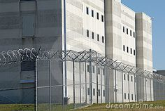 Photo about Modern jail building with fence surrounding in sunlight. Image of wire, jail, architecture - 7048784 Esl, Privacy Fences, Fencing, County Jail, Safe Haven, U.s. States, Prison, Skyscraper, Multi Story Building