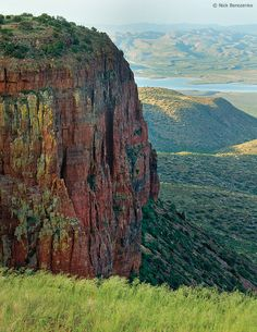 The red cliffs of Parker Canyon, set against the backdrop of Roosevelt Lake, AZ
