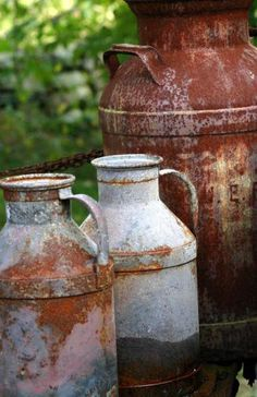 .old milk cans of various sizes  fun