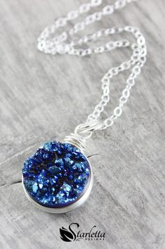 Dark Blue Druzy Silver Circle Necklace | Hand wrapped in a sterling silver wire, the 10mm dark blue druzy quartz gemstone at the heart of this necklace will bring a subtle sparkle to any occasion! #startettadesigns #handmade #jewelry #necklace #silver #gemstone