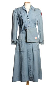 "Red Cross Uniform: ca. 1939-1945. ""The blue seersucker dress, cap and bag were all used by Katherine Simons during the war in Charleston where she worked in the Red Cross canteen and with the motor service."""