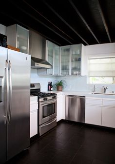 Her 250-square-foot kitchen space fits this description as well — come take a tour of this modern, cozy space