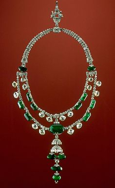 The Spanish Inquisition necklace consists of two strands of antique-cut diamonds and emeralds, to which a lower pendant and upper chain containing modern, brilliant-cut diamonds were added. The emeralds are Colombian and the diamonds are Indian. The large, central, barrel-shaped emerald weighs approximately 45 carats, one of the world's finest.