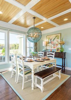 Love the paneled ceiling in this dining nook. Luxury beach living!