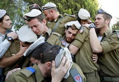 Israeli soldiers mourn during the funeral of their comrade Alex Mashavisky at a cemetery in Beersheba, Israel, January 7, 2009. Eric Gaillard: I was in Israel to help out the Reuters Jerusalem office during the Israeli offensive in the Gaza Strip in January 2009. They asked to go to Beersheba to cover the funeral of an Israeli soldier, Alex Mashavisky, who was killed in an operation in Gaza. There was so much emotion at this...