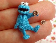 This hungry little blue guy is lovingly made by me from cotton embroidery thread. He is one inch high standing and is five way thread jointed for gentle posing and comes complete with two cookies!He i..