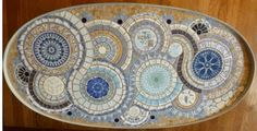 Upscaled table with mosaic table top.  The design is created from vintage dinnerware.