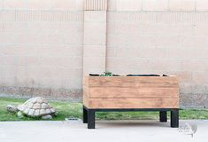Learn exactly how to build a DIY self watering wooden planter box. This sub-irrigation modern raised planter is perfect for any yard! #anikasdiylife