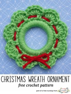 Crochet this easy wreath ring ornament or gift topper from Whiskers & Wool, a free crochet pattern in my festive crochet christmas wreaths roundup!