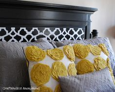 Headboard makeover using vinyl. Great way to update an old headboard!