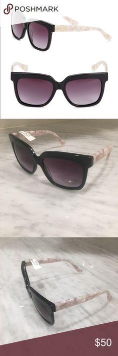 O by Oscar De Larenta Sunglasses Chic sunglasses with saddle nose bridge 55 mm lens width 17 mm bridge width 138 mm temple length Plastic Black/ivory Case not included  🕶 Oscar de la Renta Accessories Sunglasses