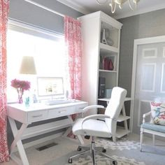 desk in front of window/grey walls/silver on door panels