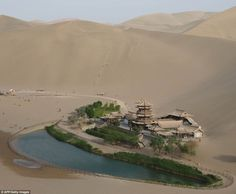 Oasis: Yueyaquan Crescent Lake in Dunhuang, north west China is completely surrounded by sand dunes. The arid region barely gets any rain each year
