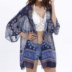 Navy Patterned Kimono Cardigan NWT. Beautiful sheer kimono cardigan. One size fits most. For size reference, see photo 4 (I'm a 12-14, wear L/XL, 36DD bust, and the kimono lays nicely on me). Tops