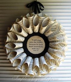 "Autumn Thanksgiving Vintage Song Book Hymnal Wreath~The centerpiece is a verse from the Bible that I printed on an old flyleaf page or parchment paper: ""I will sing unto the Lord, because he hath dealt bountifully with me."" Psalm 13:6.  It is surrounded by a hand-pleated, crepe paper ruffle."