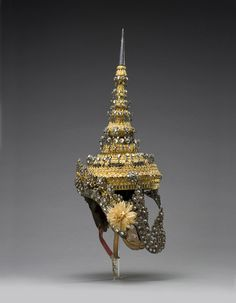 EMERALD CITIES: ARTS OF SIAM & BURMA, 1775 - 1950     Headdress for Rama's wife, Sita, in the dance-drama of the epic of Rama approx. 1950–1960 Thailand Gilded lacquer, wood, silver, glass, synthetic textile, rawhide, and paper Gift from Doris Duke Charitable Foundation's Southeast Asian Art Collection,