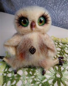 A loving couple of owls Bazhena and Lukum. Made in the technique of dry felting 100%, glass eyes handmade, polymer clay Fimo, dry pastel, сrochet and knitting. The size of the girl is 11/14 cm, the...