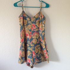 floral print cutout bow back romper adjustable strap romper in a watercolor floral type pattern, with a back detail of cutouts held with bows. great condition, hardly ever worn, stretchy but thick fabric American Rag Pants Jumpsuits & Rompers