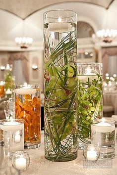 Wedding Centerpieces more clear, green, candle combinations!  I wonder what this looks like in the dark?