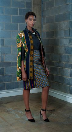 Paneled Knee Length Pencil Skirt in a vibrant linear and geometric print Front and back paneled skirt fully lined with side paneled, and 2 splits in the back. The center panel features a vibrant strip