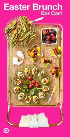 Easter brunch up a bar cart ready to sip & snack with fresh berries, deviled eggs, skewers & more.