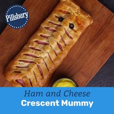 Take the spook out of deciding what's for Halloween dinner with this simple ham and cheese crescent mummy! food for party videos appetizers dip recipes Ham and Cheese Crescent Mummy Appetizers For Kids, Halloween Appetizers, Halloween Dinner, Halloween Food For Party, Appetizer Recipes, Lunch Recipes, Halloween Meals, Dinner Recipes, Fall Recipes