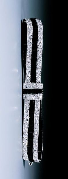Cartier ,A very fine Art Deco onyx and diamond bow brooch