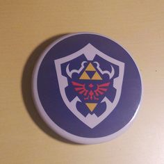 Hylian Shield The Legend Of Zelda inspired Button by SaavyInc Juventus Logo, Legend Of Zelda, Make And Sell, Video Games, Anime, Nerd, Geek Stuff, Batman, Buttons
