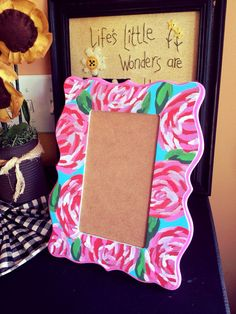 One of my favorite creations yet and by far a best seller! This is a hand-painted Lilly Pulitzer inspired picture frame.