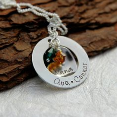 Show off your Amazing Family with this beautiful hand stamped Necklace. Add up to 5 names along the bottom washer pendant and 1 name or date to the heart. A per