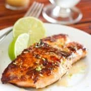 Flavorful, easy to make salmon with a simple garlic lemon butter sauce. Seared in a skillet on the stove top and ready in 20 minutes!