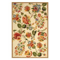 Hand-hooked wool rug with a floral motif.   Product: RugConstruction Material: WoolColor: Ivory a...
