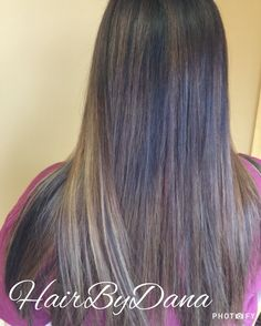 Dana has been slowly transitioning this client to lighter hair (from black, box color) using balayage with lots of dimension!  Color design by Dana