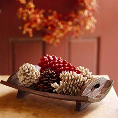 A fresh coat of color enhances the subtle charm of pinecones. Fill a wooden dish with pinecones painted to show off their texture in a display./