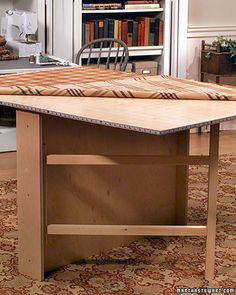 Fold away sewing/craft table.  Legs fold in and leaves fold down to leave you with a 4-6 inch wide stow-away table.  By Martha Stewart