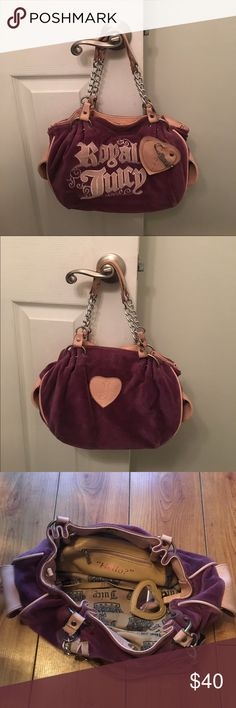 Juicy Couture handbag Purple velour with pink leather Juicy handbag. Two small pockets on either side of the bag that button shut. Inside has a zipper pocket along with 2 small pockets. There is also an attached mirror on the inside of the bag. Clasp on the inside to close bag more. Juicy Couture Bags Shoulder Bags