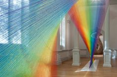 Plexus A1 by Gabriel Dawe, 2015. Dawe's architecturally scaled weavings are often mistaken for fleeting rays of light. It is an appropriate trick of the eye, as the artist was inspired to use thread in this fashion by memories of the skies above Mexico City and East Texas, his childhood and current homes, respectively. The material and vivid colors also recall the embroideries everywhere in production during Dawe's upbringing.