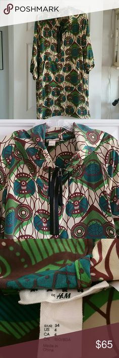 Rare Marni for H&M Anorak Dress Silk Hooded Anorak Parka Style Peacock Print Dress by Marni for H&M 2011 colkection - very hard to find. In great condition have worn only a few times.  Has a teeny stain or watermark on the front pouch / pocket -  it is not noticeable when wearing.  See photo for details H&M Dresses