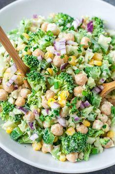 This tasty chopped cauliflower broccoli salad with creamy avocado dressing features a medley of broccoli, cauliflower, corn, and chickpeas!. GF + Vegetarian