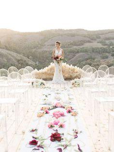 Modern Desert Wedding Ceremony with a Flower Aisle Runner | Carlie Statsky Photography | Unique Floral Design Inspiration for Spring Weddings!