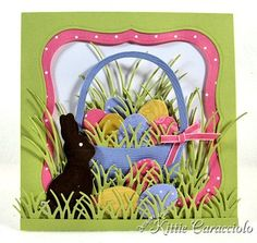 KC Impression Obsession...Chocolate Bunny Easter Basket...I created a double matted frame to highlight my scene and mounted it to the card base with mounting tape. I cut the basket, several eggs and lots of grass pieces and grass borders.