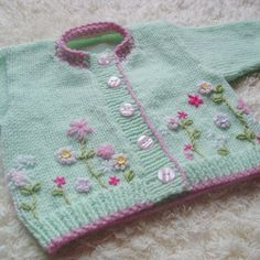 Mint Blush Beautiful baby cardigan with embroidered flower detail, hand knit using soft mint baby yarn and a warm pink contrast. Baby Knitting Patterns, Knitting For Kids, Baby Patterns, Knitting Projects, Hand Knitting, Knitting For Beginners, Sweater Patterns, Cardigan Bebe, Knitted Baby Cardigan