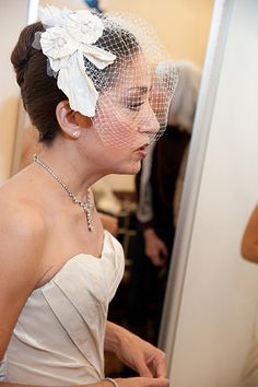 Our bride Debra wearing a custom headpiece we made from a piece of her gown.
