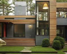 Wood & stone modern mansion in the woods