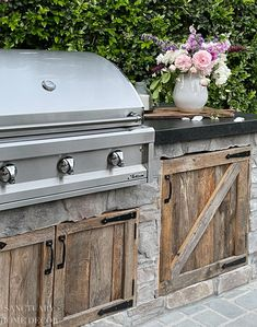 Given the rustic nature of our garden, we also didn't want a ton of stainless steel doors on the front of the BBQ center, so we decided to use some reclaimed barn wood that was leftover from when we built our barn. We had the doors custom made to match the barn stall doors. Modern Farmhouse Design, Farmhouse Style, Outdoor Spaces, Outdoor Decor, Outdoor Living, Outdoor Kitchens, Bbq Island, Built In Bbq, Stainless Steel Doors