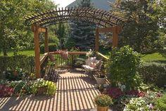 An arched pergola creates the perfect garden getaway