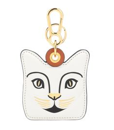 Loewe - Cat leather bag charm - Loewe's menagerie receives a delightful new addition with this Eastern-inspired cat. Crafted from white leather, the bag charm features black and gold paint and contrast stitching along the edges. This playful visage hangs from a golden key clip that can be attached to your favourite Puzzle bag. seen @ www.mytheresa.com