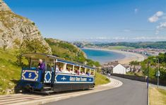 Blue carriage of a tram on The Great Orme Tramway overlooking Llandudno bay, North Wales, UK, Europe