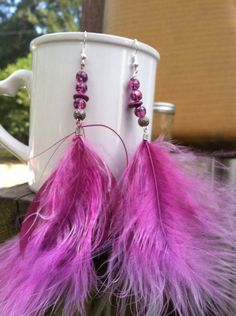 Pink feather and beads dangle earrings on Etsy, $15.00