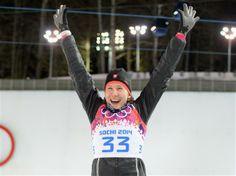 Gold medalist Anastasiya Kuzmina of Slovakia celebrates during the flower ceremony after the Women's 7.5 km Sprint